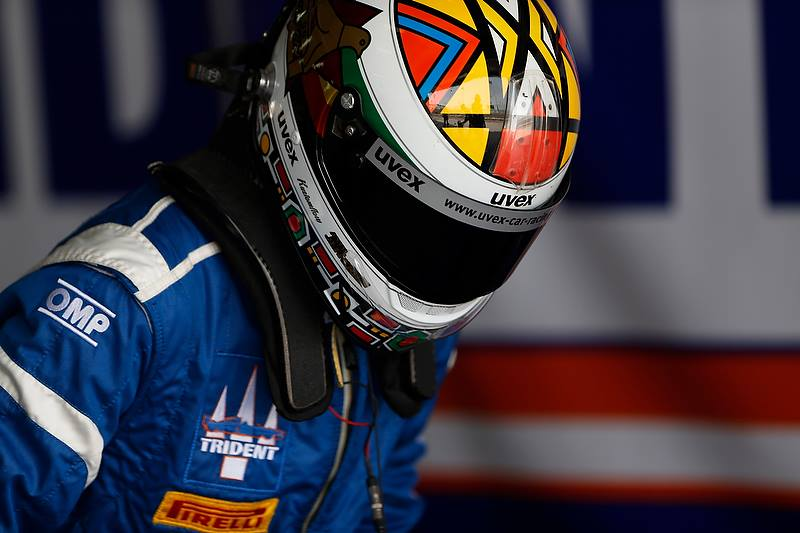 Axcil Jefferies climbing into his Trident Motorsport GP2 car in Bahrain featuring his Kustomflow painted helmet